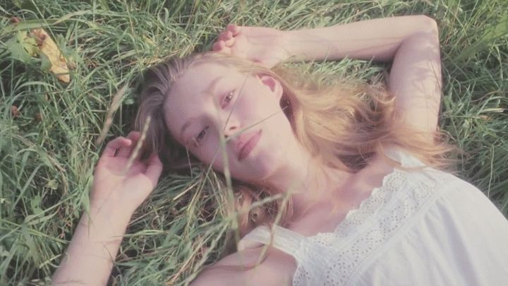Serene TVC for the perfume Daisy by Marc Jacobs shot in Bavaria and featuring a woman walking through idilic long grass.